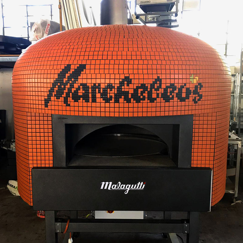 An orange Napoli fired oven with a custom branded tiling for Marcheleos.