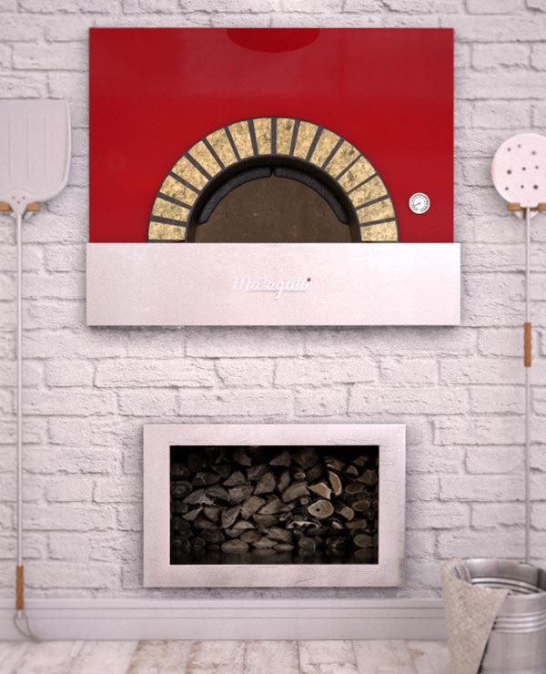 Milano fired oven with a red finish enclosed within a decorated brick wall.