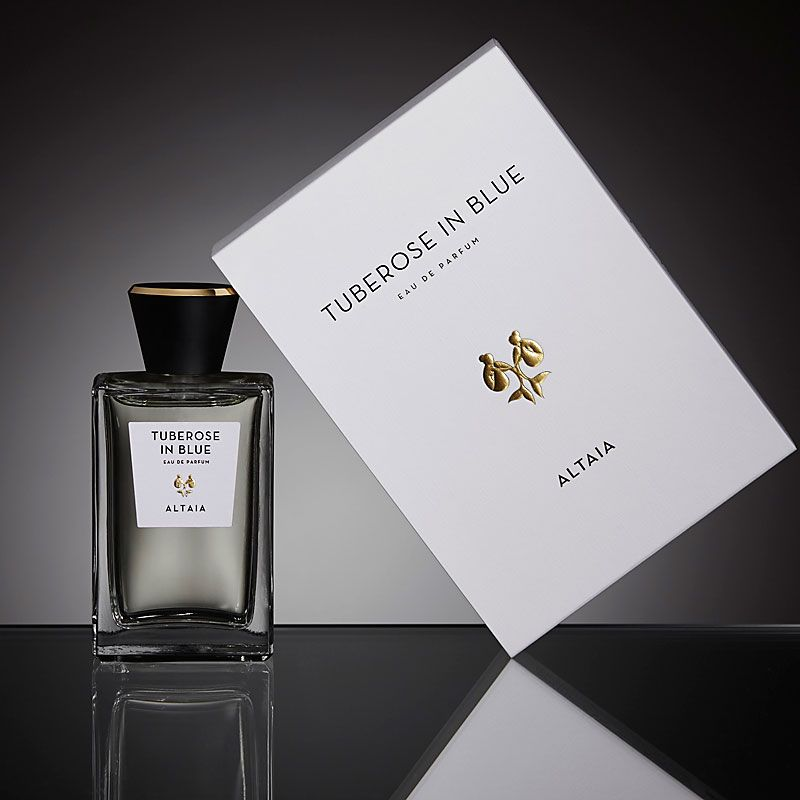 Beauty shot of ALTAIA Tuberose in Blue Eau de Parfum - 100 ml with box and black background