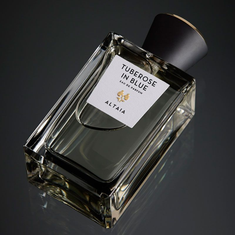 Beauty shot of ALTAIA Tuberose in Blue Eau de Parfum - 100 ml shown top view with a black background