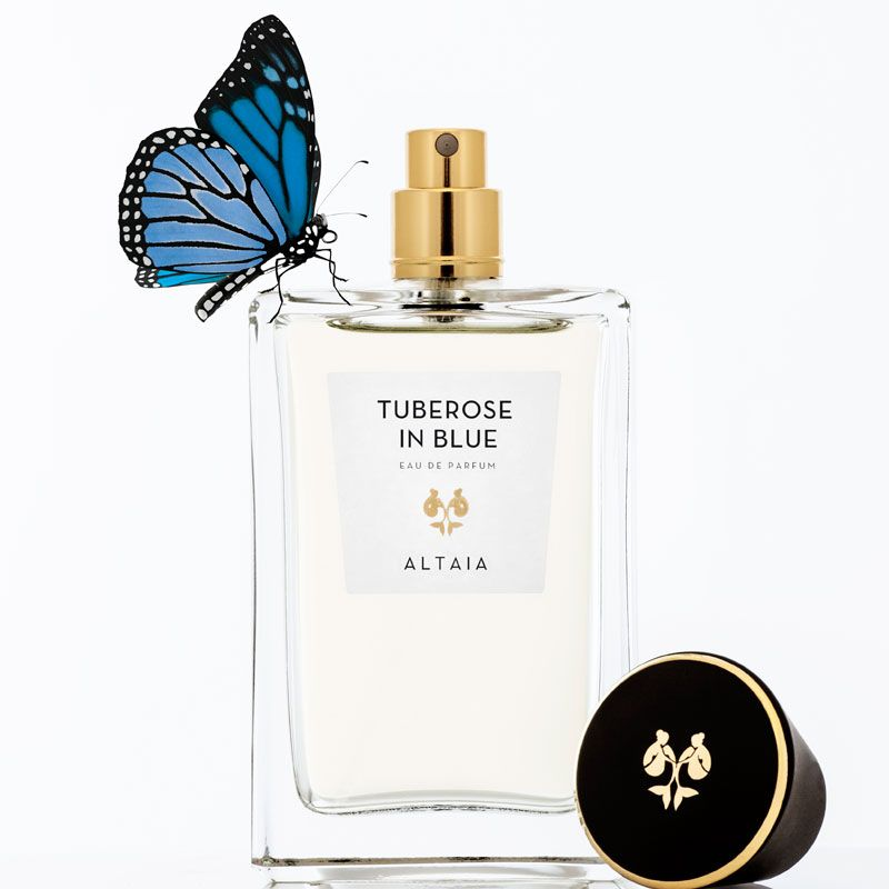 Beauty shot of ALTAIA Tuberose in Blue Eau de Parfum - 100 ml with cap off and blue butterfly on bottle