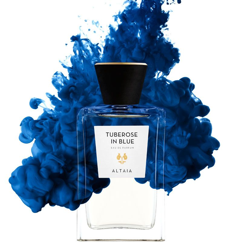 Beauty shot of ALTAIA Tuberose in Blue Eau de Parfum - 100 ml with blue liquid in the background