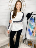 Always Care- White Knit Sweater w/ Black Floral Sleeve Strip