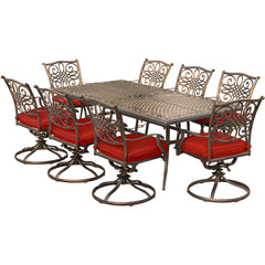 hanover-traditions-9-piece-8-swivel-rockers-42x84-inch-cast-table-trad9pcsw8-red