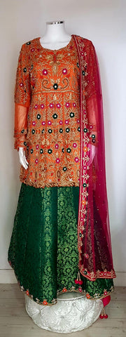 A beautiful ladies mandi suit orange / green