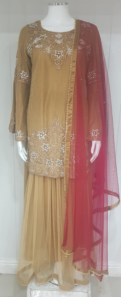 A Gold colour ladies langha suit  with  maroon duptta