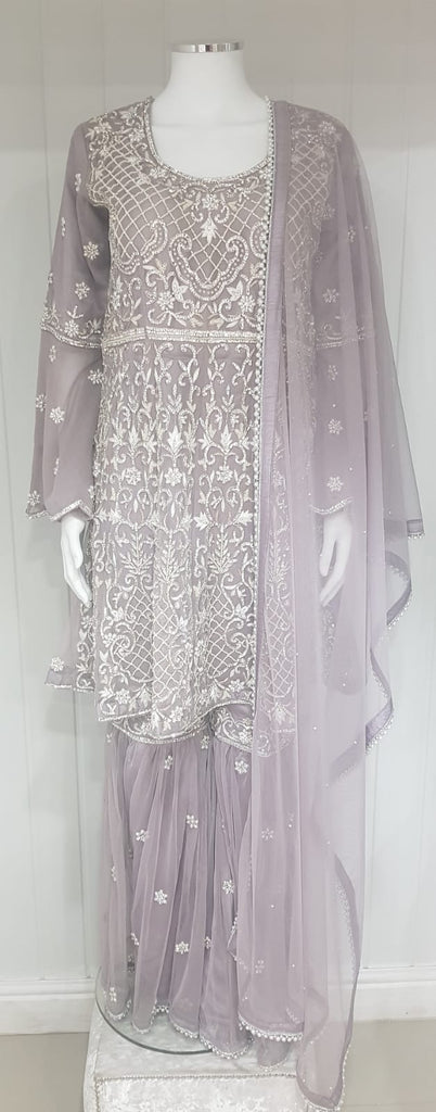 A Ladies sharara suit with bell sleeve ###