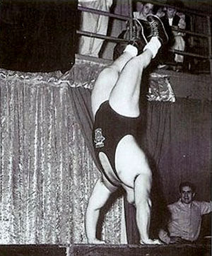 305 lb Doug Hepburn Performing a Handstand Pushup