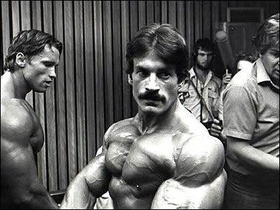 Backstage at the 1980 Mr Olympia - Mike Mentzer and Arnold Schwarzenegger