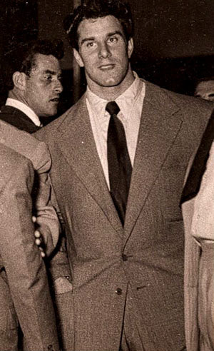 Young Reg Park in Suit Looking Massive