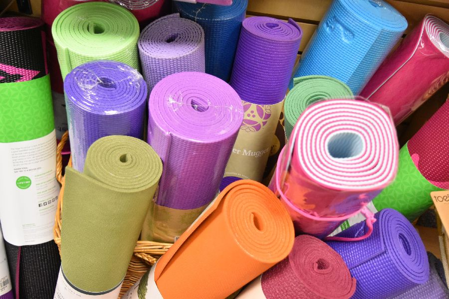 Yoga mats and supplies at East West Bookshop!