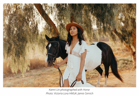 Kamri Lin photographed with a Horse
