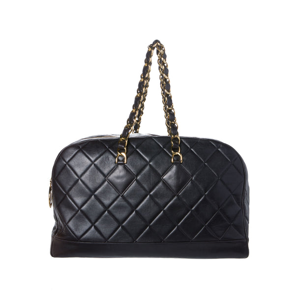Chanel Black Lambskin Quilted XL Travel Bag. Spectacular! Coco et Louis