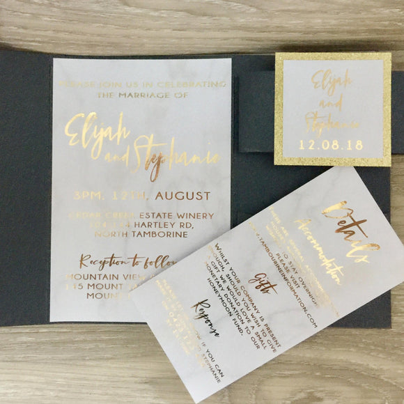 Black pocket fold wedding invitation with gold foil and marble detail
