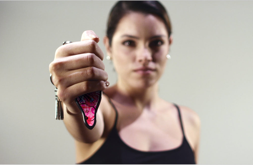 yModel holding MUNIO Self Defense Keychain in AsSeenOnTV commercial