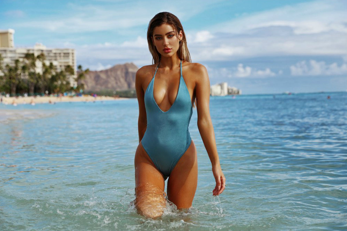 Model wearing TJ swim one piece