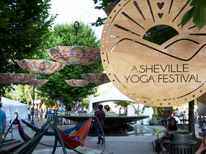 Special Event: WND Asheville Umbrellas Crown Pack Square at Asheville Yoga Festival.