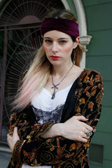 Witches Brew necklace with squirrel claw and crossbones worn by severine arend