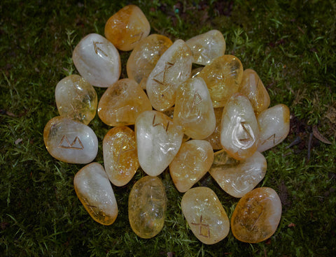 A beautiful Citrine Rune set handmade by Elfhame's resident witch. These runes feature the Elder Futhark including one blank rune for divinatory workings.