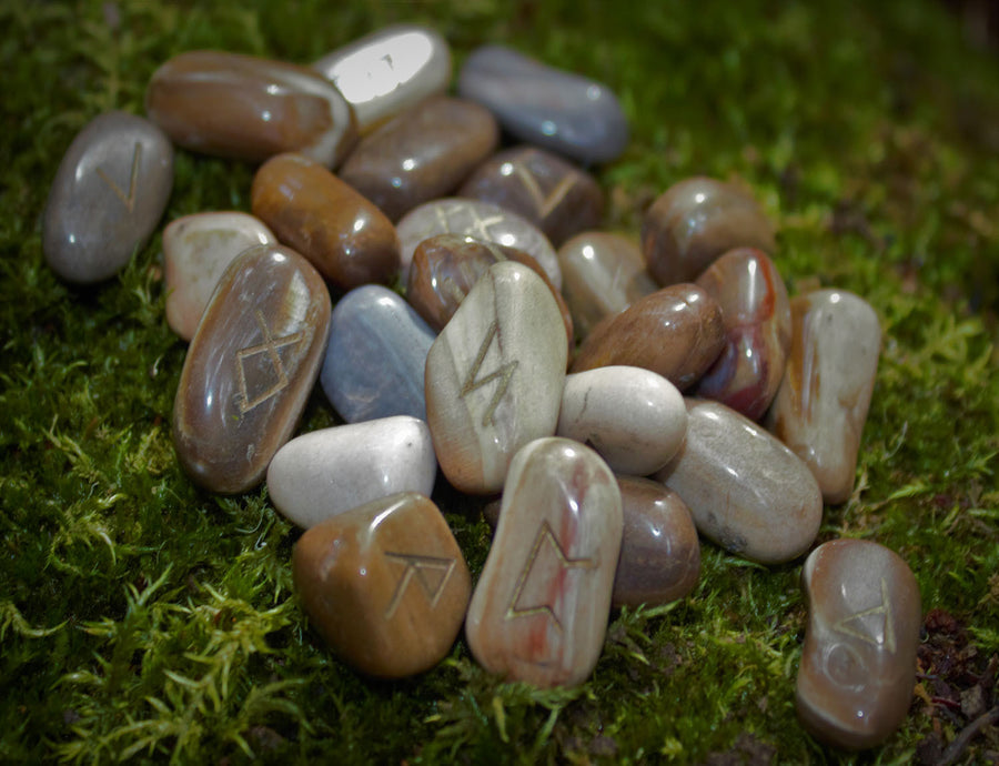A beautiful Stone Rune set handmade by Elfhame's resident witch. These runes feature the Elder Futhark including one blank rune for divinatory workings.