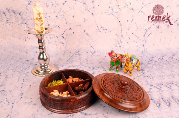 Hand carved dry fruit box made of sheesham wood