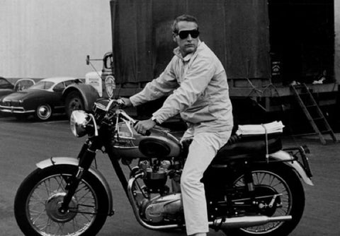 ‍‍Paul Newman on his Triumph motorcycle on a set.