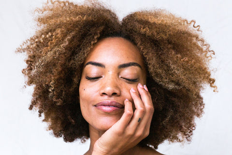 Woman with natural hair protein treatment miche beauty