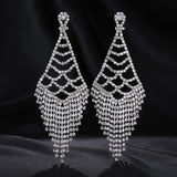""" Behold "" Long Clear Rhinestone Crystal Earrings On Silver Tone"