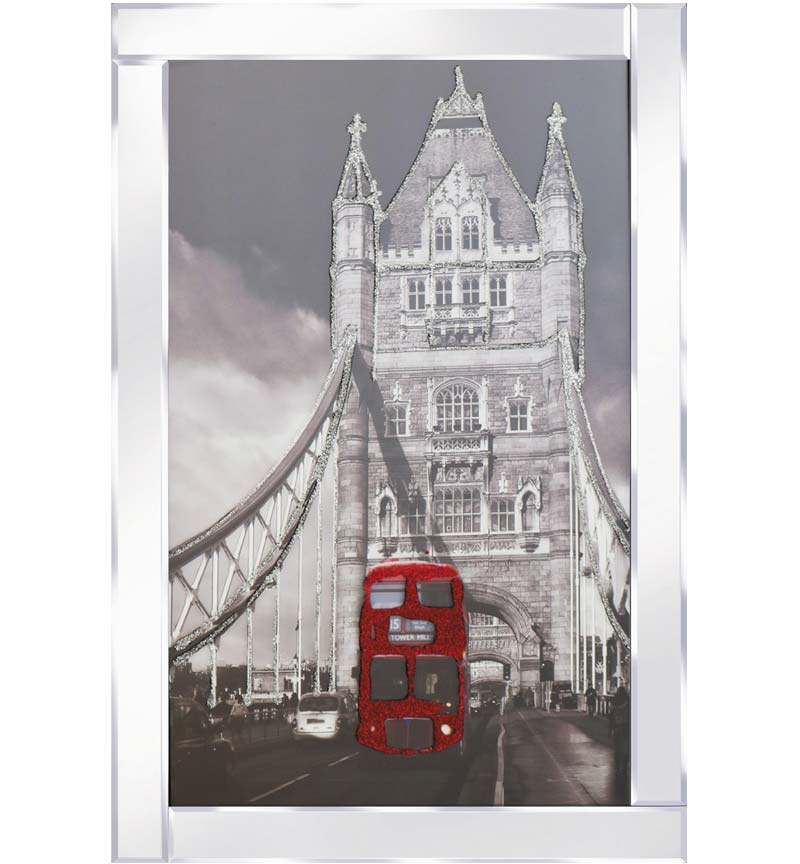 Red Buss On London Bridge with a Mirrored Frame. The design itself is beautifully rendered with Liquid Glitter. The modest proportion of the mirrored frame is suitable for most room sizes.