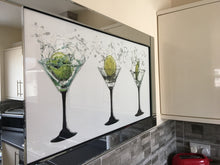 Load image into Gallery viewer, Three cocktail glasses beautifully rendered with Liquid Glitter. The modest proportion of the mirrored frame is suitable for most room sizes.