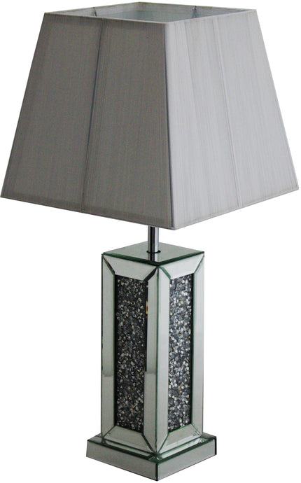 The Gatsby Crystal Table Lamp is made of mirrored glass and has diamond like crystal centres. Part of the Gatsby range, this modern table lamp is an added luxury to any home or business.