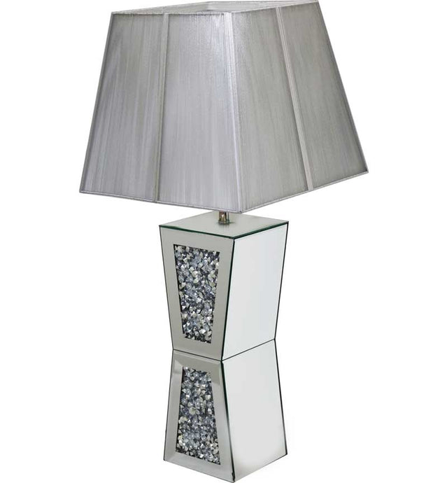 The Gatsby Crystal Plinth Table Lamp is made of mirrored glass and has diamond like crystal centres. Part of the Gatsby range, this modern table lamp is an added luxury to any home or business.
