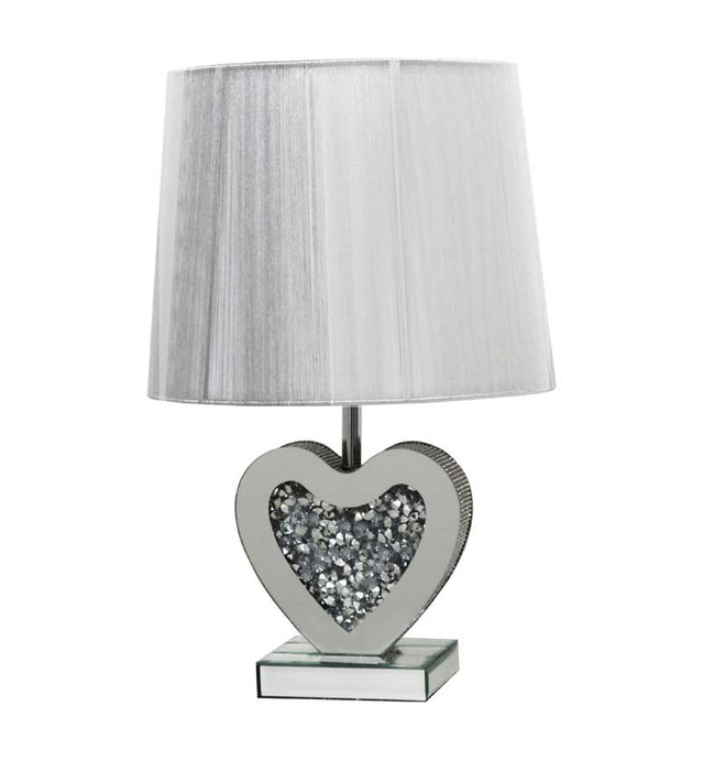 The Gatsby Crystal Heart Table Lamp is made of mirrored glass and has a diamond like crystal heart. Part of the Gatsby range, this modern table lamp is an added luxury to any home or business.