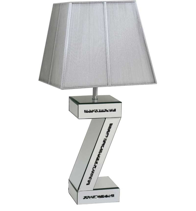 The Gatsby Crystal Z Table Lamp is made of mirrored glass and has diamond like crystal centres. Part of the Gatsby range, this modern Table lamp is an added luxury to any home or business.