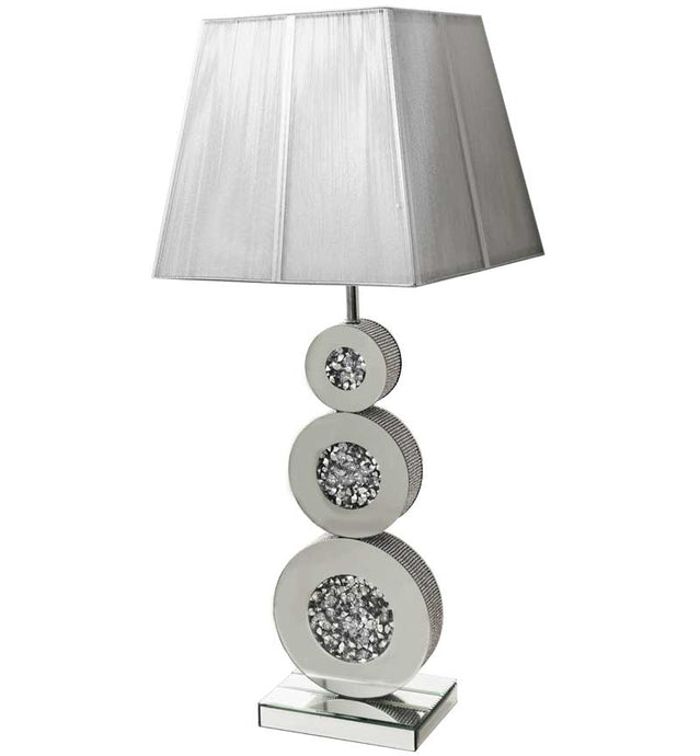 The Gatsby Crystal 3 Circle Table Lamp is made of mirrored glass and has a diamond like crystal circles. Part of the Gatsby range, this modern table lamp is an added luxury to any home or business.
