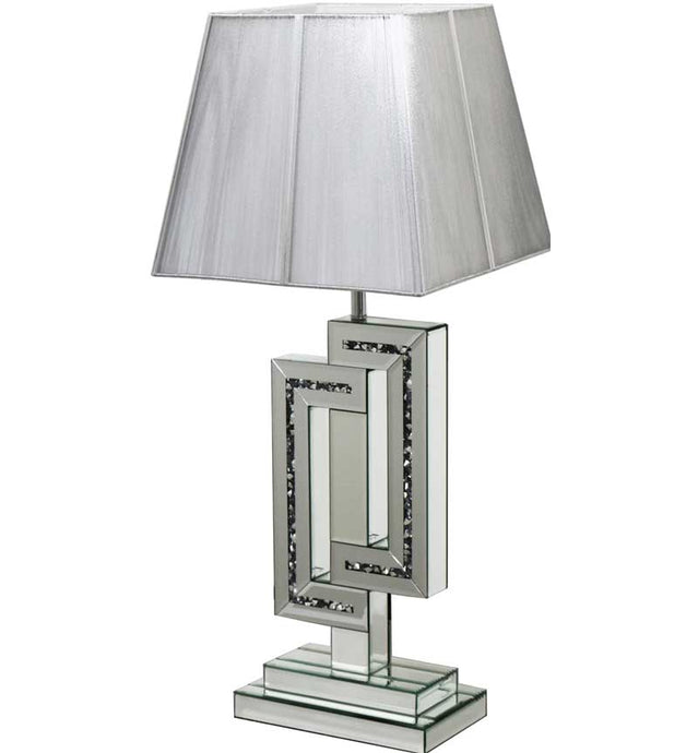 The Gatsby Crystal Deco Table Lamp is made of mirrored glass and has diamond like crystal centres. Part of the Gatsby range, this modern table lamp is an added luxury to any home or business.