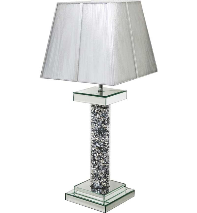 The Gatsby Round Crystal Pillar Table Lamp is made of mirrored glass and has diamond like crystal centres. Part of the Gatsby range, this modern table lamp is an added luxury to any home or business.