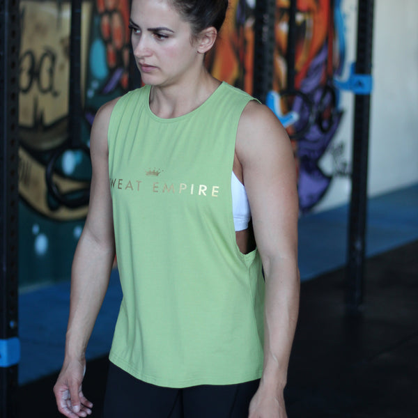 ladies un-limited muscle gold print green front