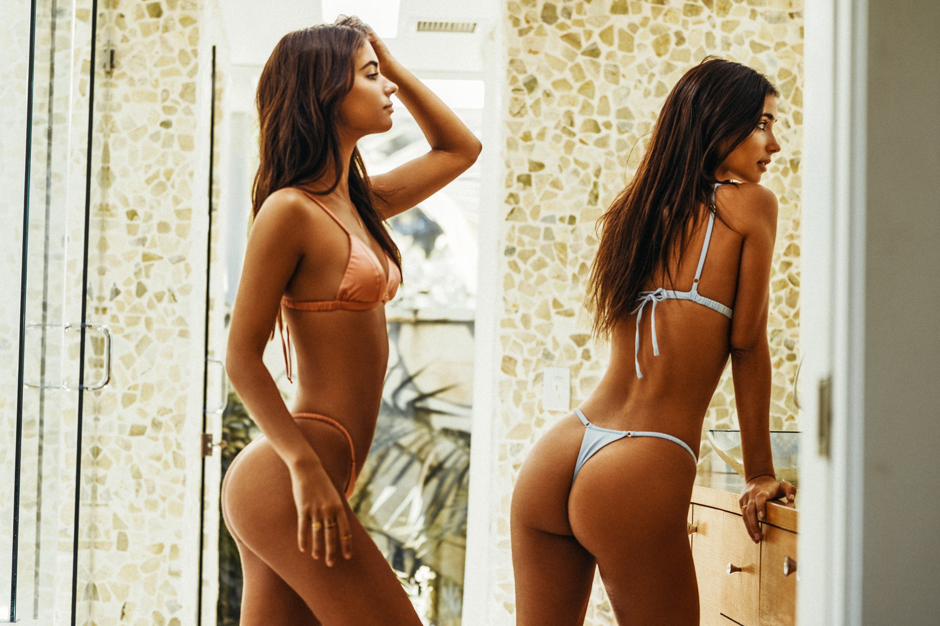 Elisha and Renee Herbert wearing the Delight Peach and Baby Blue underwear set while in the bathroom