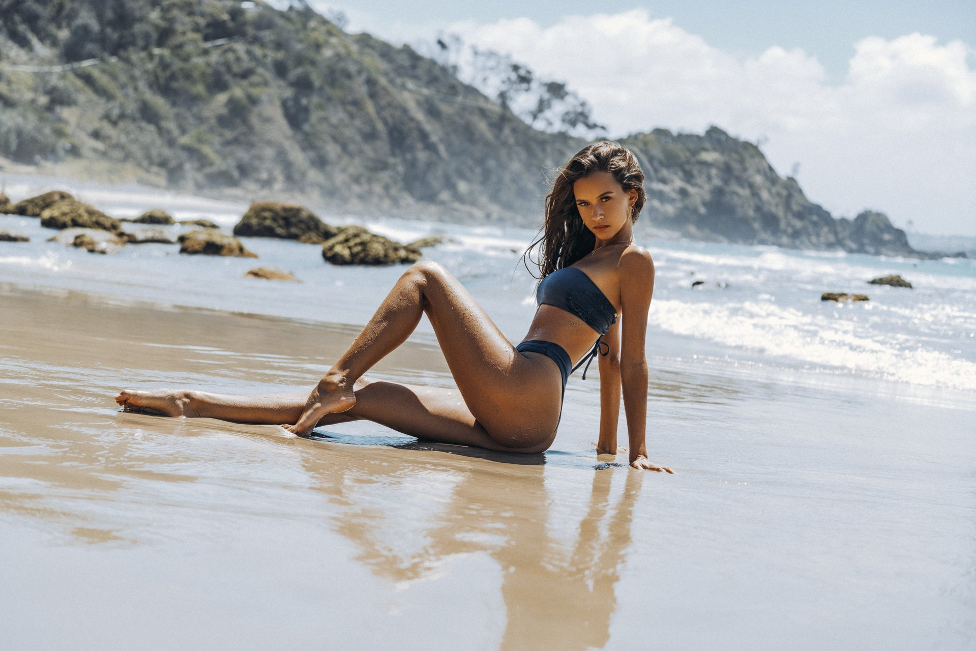 Isabelle Mathers wearing the For You Bikini Bandeau Set Deep Blue on the beach