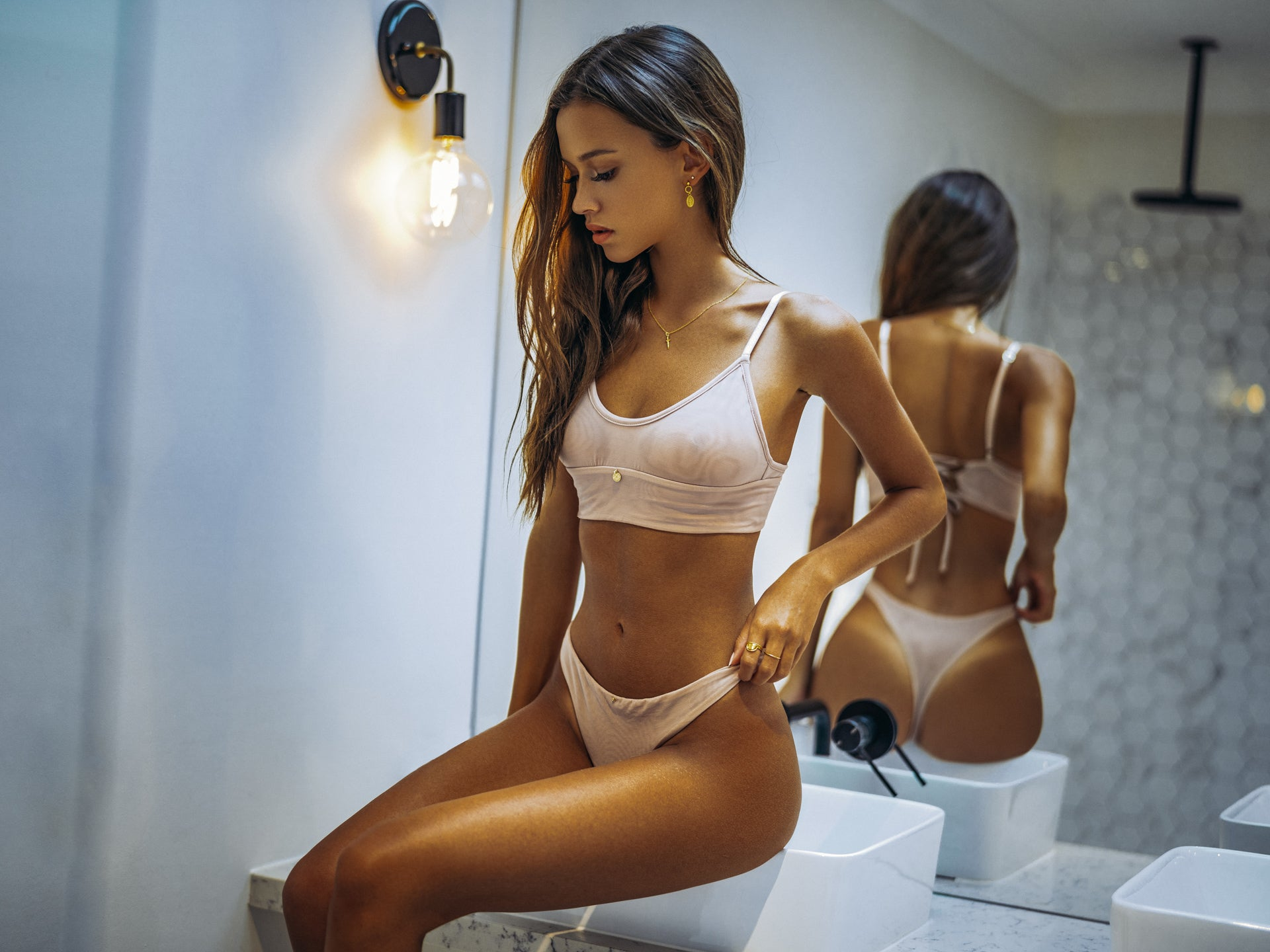 Isabelle Mathers wearing the For You Nude Triangle Set in a bathroom
