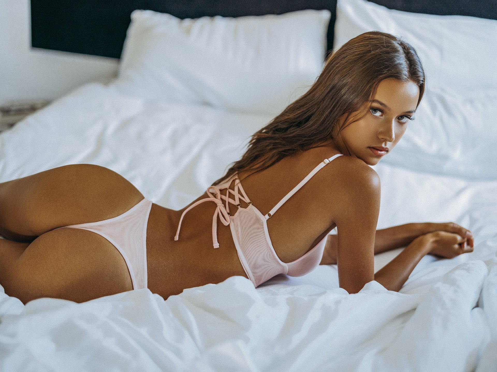 Isabelle Mathers wearing the For You Baby Pink Crop Set while lying down on a bed