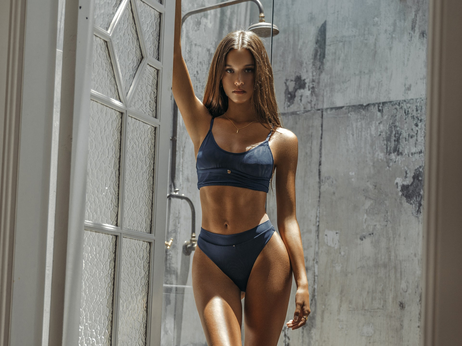 Isabelle Mathers wearing the For You Deep Blue Crop Set while in the shower