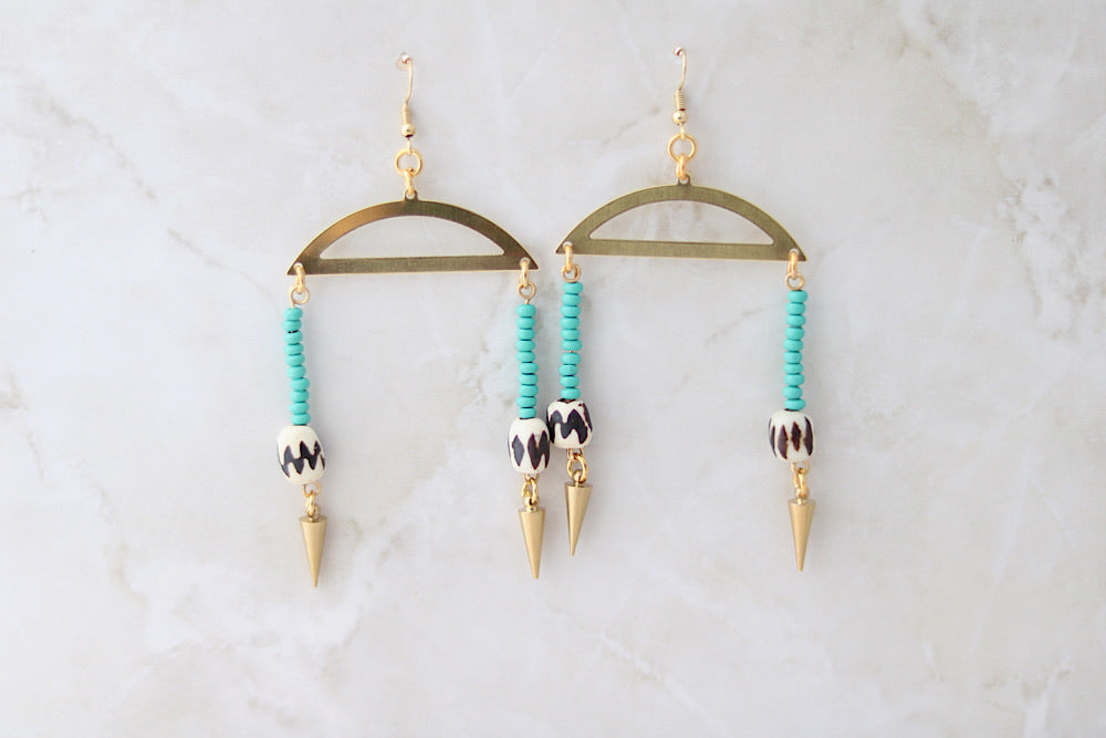 Turquoise beaded earrings with batik bone and spikes