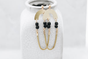 Brass earrings with black glass beads