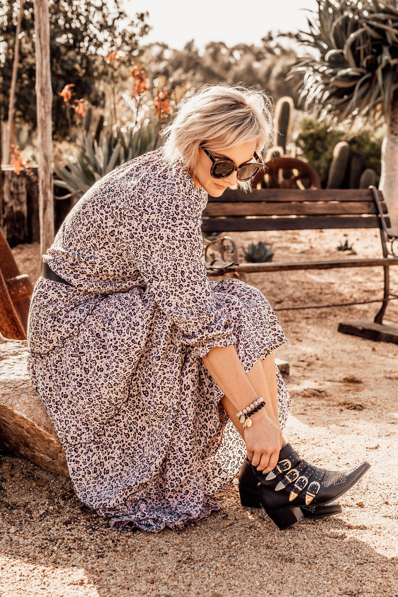 "Long Sleeve Womens Boho Maxi Dress ""Audrey"" Perth Australia Spring Summer Collection.  Animal Print. Long Sleeve.  Worn Belted with Boots.  Background is Arid landscape featuring succulents"