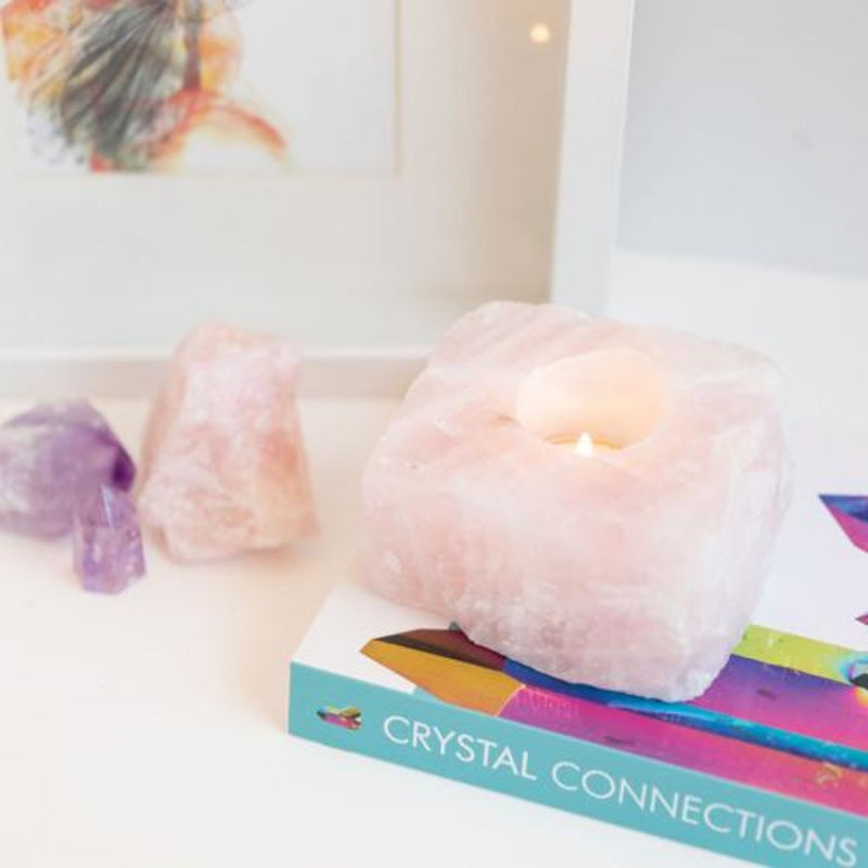 Candle Crystal Homewares Love  Rose Quartz Rough Cut. Pale Pink Square cut rose quartz crystal .  Sits on Crystal Connection Book from side view.  Contains light tealight with amethyst and rose quartz in background
