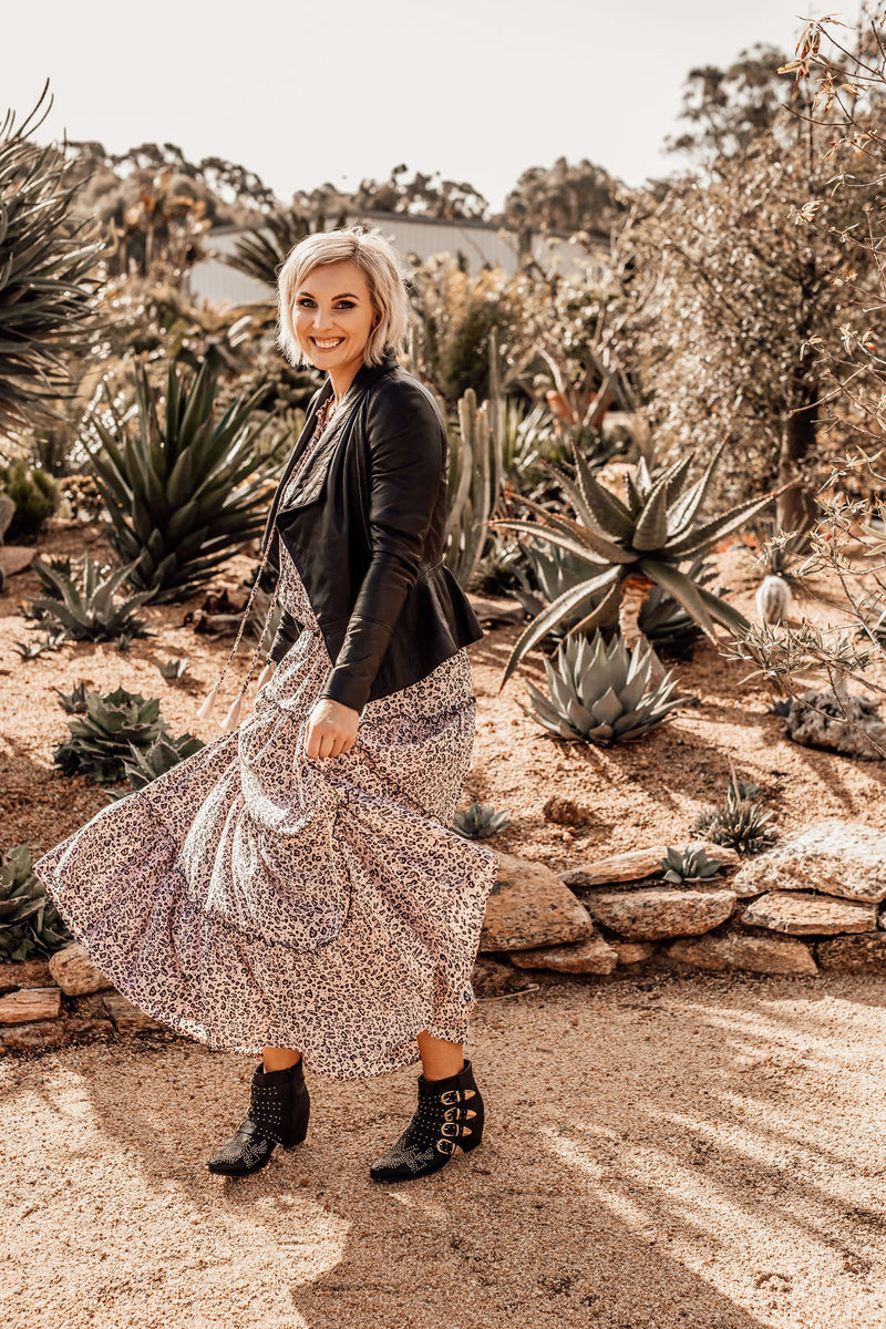 Animal Print Boho Maxi Dress.  Womens Spring Summer Perth Australia.  Worn with Leather Jacket and Boots.  Model is smiling and twirling with an arid landscape background of cacti and succulents.