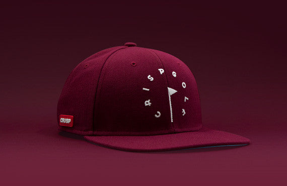 101 series burgundy red coloured structured 6-panel golf cap with premium wool blend fabric, leather strap and branded white buckle
