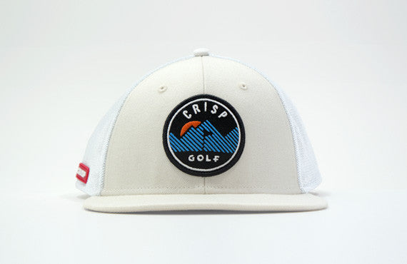 103 series off white structured 6-panel golf cap with a wool blend crown, fine mesh side/back panels, a plastic closure and an embroidery patch with mountain logo
